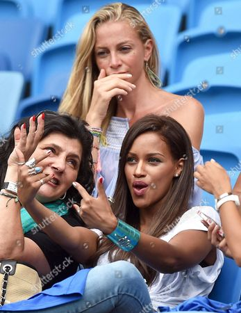 Fanny Neguesha (r) Fiancee of Italy's Mario Balotelli and Valentina Baldini (top) Girlfriend of Italy's Andrea Pirlo Pose Prior the Fifa World Cup 2014 Group D Preliminary Round Match Between Italy and Uruguay at the Estadio Arena Das Dunas in Natal Brazil 24 June 2014 (restrictions Apply: Editorial Use Only not Used in Association with Any Commercial Entity - Images Must not Be Used in Any Form of Alert Service Or Push Service of Any Kind Including Via Mobile Alert Services Downloads to Mobile Devices Or Mms Messaging - Images Must Appear As Still Images and Must not Emulate Match Action Video Footage - No Alteration is Made to and No Text Or Image is Superimposed Over Any Published Image Which: (a) Intentionally Obscures Or Removes a Sponsor Identification Image; Or (b) Adds Or Overlays the Commercial Identification of Any Third Party Which is not Officially Associated with the Fifa World Cup) Brazil Natal