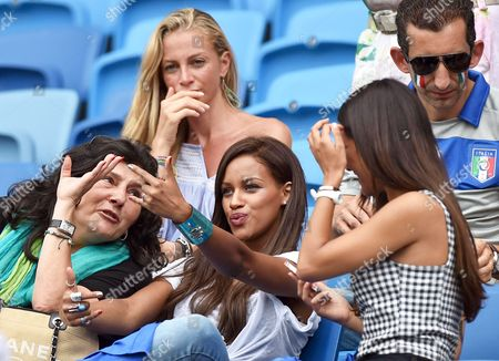 Fanny Neguesha (c) Fiancee of Italy's Mario Balotelli Federica Riccardi (r) Girlfriend of Italy's Alessio Cerci and Valentina Baldini (top) Girlfriend of Italy's Andrea Pirlo Pose Prior the Fifa World Cup 2014 Group D Preliminary Round Match Between Italy and Uruguay at the Estadio Arena Das Dunas in Natal Brazil 24 June 2014 (restrictions Apply: Editorial Use Only not Used in Association with Any Commercial Entity - Images Must not Be Used in Any Form of Alert Service Or Push Service of Any Kind Including Via Mobile Alert Services Downloads to Mobile Devices Or Mms Messaging - Images Must Appear As Still Images and Must not Emulate Match Action Video Footage - No Alteration is Made to and No Text Or Image is Superimposed Over Any Published Image Which: (a) Intentionally Obscures Or Removes a Sponsor Identification Image; Or (b) Adds Or Overlays the Commercial Identification of Any Third Party Which is not Officially Associated with the Fifa World Cup) Brazil Natal