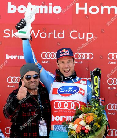 Norwegian Aksel Lund Svindal (r) Celebrates on the Podium with Former Italian Ski Racer Alberto Tomba (l) After Winning the Men's Downhill Race at the Alpine Skiing World Cup in Bormio Italy 29 December 2013 Italy Bormio