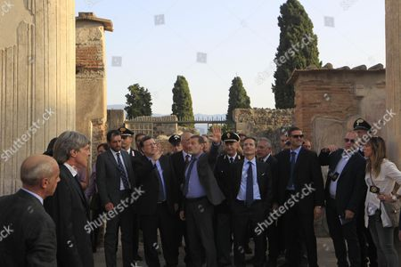 President of the European Commission Jose Manuel Durao Barroso (l) with the Superintendent of Pompeii Massimo Osanna (c) During His Visit at the Pompeii's Archaeological Excavations Italy 10 October 2014 Italy Pompei