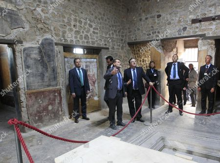President of the European Commission Jose Manuel Durao Barroso (r) with the Superintendent of Pompeii Massimo Osanna During His Visit at the Pompeii's Archaeological Excavations Italy 10 October 2014 Italia Pompei