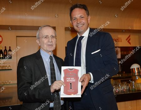 Us Former Professional Basketball Head Coach Daniel Lowell 'Dan' Peterson (l) with Uc Sampdoria's Coach Sinisa Mihajlovic During the Presentation of His Book 'Per Me Numero1 (for Me Number 1)' in Genoa Italy 20 March 2014 Peterson Spent Most of His Professional Coaching Career in Italy Italy Genova