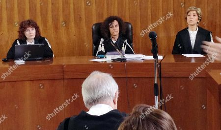 Stock Image of The Presiding Judge Giulia Turri (c) and Judges Carmen D'elia (r) and Ursuline De Cristofaro Listen to the Summary of the the Closing Argument in the Berlusconi Trial Milan June 3 2013 Italy Milan