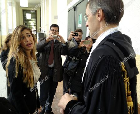 Showgirl Belen Rodriguez Talks with Lawyer Nicolo' Ghedini at a Court House in Milan 05 November 2012 Belen Rodriguez Has Been Cited As a Witness by the Defense of Italian Former Prime Minister Silvio Berlusconi Accused of Paying Moroccan Nightclub Dancer Karima El Mahroug Also Known by the Stage Name Ruby Rubacuori For Sexual Services Between February and May 2010 when She was Under the Age of 18 and For Abuse of Office Relating to Her Release From Detention Italy Milan