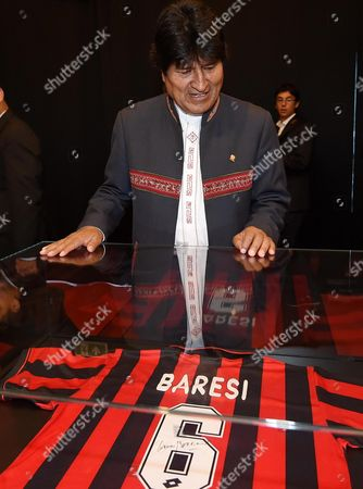 Bolivian President Evo Morales Looks at a Jersey of Former Soccer Player Franco Baresi During a Visit at the Ac Milan Musem at the Ac Milan Headquater in Milan Italy 13 June 2015 Italy Milan