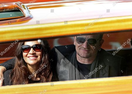 Irish Singer Bono (r) of U2 and His Wife Ali Hewson Leave the Hotel Cipriani Aboard a Taxi Boat For the Ca Farsetti Palazzo in Venice Italy 29 September 2014 the Couple Attended the Civil Wedding Ceremony of Us Actor George Clooney and His Wife Lebanese-british Lawyer Amal Alamuddin at Venice's Town Hall on 29 September Following Their Private Marriage Ceremony at the Aman Canal Grande Hotel in the Citys San Polo District on 27 September Italy Venice