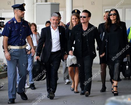 Irish Lead Singer of U2 Bono (2-r) and His Wife Ali Hewson (r) Arrive at the Marco Polo Airport in Venice Italy 27 September 2014 Bono and His Wife Are Guests of the Wedding of Us Actor George Clooney and His Fiancee Lebanese-british Lawyer Amal Alamuddin That Reportedly Takes Place in Venice This Weekend Italy Venice