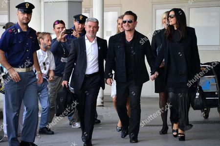 Irish Lead Singer of U2 Bono (c) and His Wife Ali Hewson (r) Arrive at the Marco Polo Airport in Venice Italy 27 September 2014 Bono and His Wife Are Guests of the Wedding of Us Actor George Clooney and His Fiancee Lebanese-british Lawyer Amal Alamuddin That Reportedly Takes Place in Venice This Weekend Italy Venice