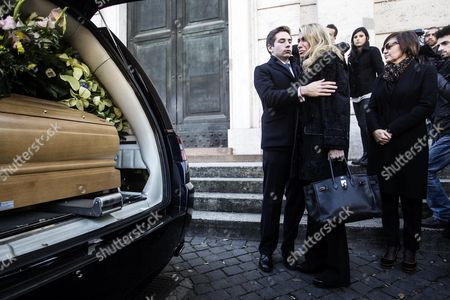 Stock Photo of Angelo Rizzoli's Wife Melania (c) and His Son (l) Stand Next the Coffin of the Late Italian Film Producer Angelo Rizzoli During a Funeral Ceremony in Rome Italy 13 December 2013 Angelo Rizzoli 70 Died on 12 December 2013 in Rome Italy Rome
