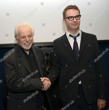 Chilean Filmmaker Alejandro Jodorowsky (l) and Danish Director Nicolas Winding Refn (r) Shake Hands During a Press Conference on the Release of the 'Refn' Home Video Film Box Set with the Movies 'Drive' and 'Only God Forgives' in Rome Italy 16 December 2013 Refn Dedicated His 2013 Movie 'Only God Forgives' to Jodorowsky Italy Rome