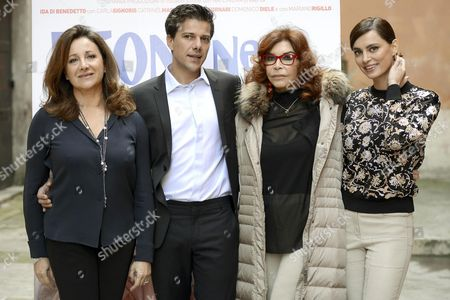 (l-r) Italian Actors/cast Members Carla Signoris Domenico Diele and Ida Di Benedetto and Romanian Actress/cast Member Catrinel Menghia Pose For Photographs During the Photocall For 'Leone Nel Basilico' in Rome Italy 04 December 2015 the Movie Will Be Released in Italian Theaters on 10 December Italy Rome