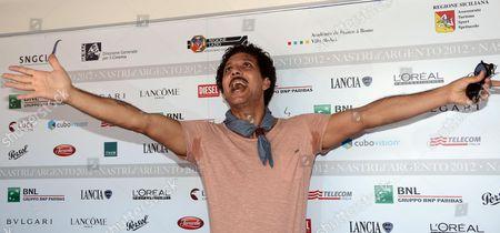 Italian Actor Giuseppe Fiorello Poses Prior to the Press Conference of the 2012 Nastri D'argento (silver Ribbon) Awards in Taormina Sicily Island Italy 30 June 2012 Fiorello Won the Premio Lancia - Nastri D'argento 2012 For His Elegance and Innovative Style Italy Taormina