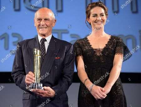 French Actor Philippe Leroy (l) Poses For Photos After He Received the 'Cariddi Award' From His Daughter Cecilie (r) During the Taormina Film Festival at the Teatro Antico in Taormina Sicily Island Italy Late 20 June 2013 the 59th Edition of the Festival Runs From 15 Until 22 June Italy Taormina
