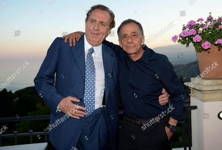 Italian Singer Roberto Vecchioni (r) and Italian Showman Michele Mirabella Pose For Photographs During a Party of the Taormina Film Festival at the Teatro Antico in Taormina Sicily Island Italy Late 19 June 2013 the 59th Edition of the Festival Runs From 15 to 22 June Italy Taormina
