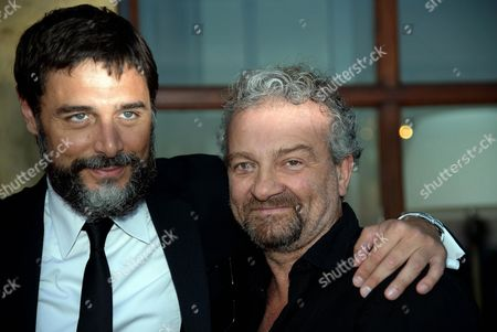 Italian Actor Daniele Pecci (l) and Italian Director Giovanni Veronesi Pose For Photographs During a Party of the Taormina Film Festival at the Teatro Antico in Taormina Sicily Island Italy Late 19 June 2013 the 59th Edition of the Festival Runs From 15 to 22 June Italy Taormina