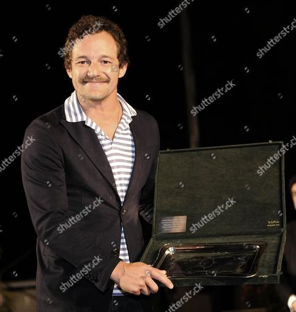 Italian Actor and Director Brando De Sica Smiles After He Received the Taormina Award During a Party For the Preview of the 60th Taormina Film Festival in Messina Sicily Island Italy 14 June 2014 the Festival Runs From 14 to 21 June Italy Taormina