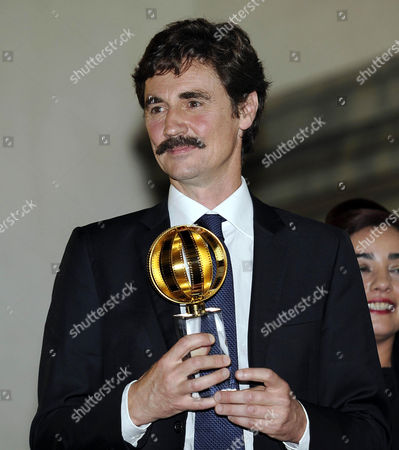 Stock Image of Italian Director Edoardo Winspeare Poses on the Stage After Receiving the Foreign Press Grand Prix Award For 'In Grazia Di Dio' During the Globo D'oro Awards Ceremony at the Palazzo Farnese in Rome Italy 12 June 2014 the Globo D'oro is an Italian Film Award Given Annually by the Journalists of the Foreign Press Accredited in Italy Italy Rome