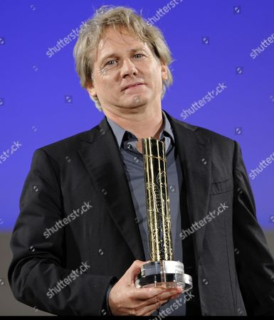 Italian Actor Giulio Scarpati Holds His 'Cariddi Award' During the Awards Ceremony at the Teatro Antico During the 60th Taormina Film Festival Festival in Taormina Sicily Island Italy 19 June 2014 the Festival Runs From 14 to 21 June Italy Taormina