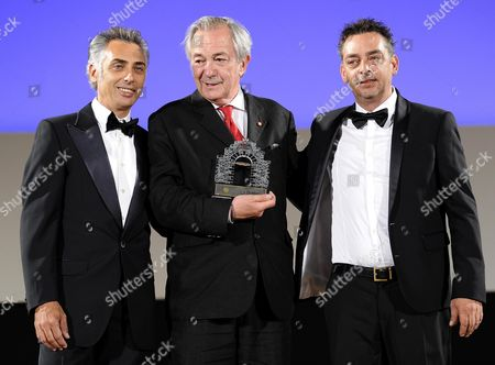 Italian Actor Remo Girone (c) Receives the 'Citta Di Taormina - La Botte' Award From Antonio Chemi (r) and Giuseppe Chemi (l) During a Ceremony at the Teatro Antico As Part of the 60th Annual Taormina Film Festival Festival Taormina Sicily Island Italy 16 June 2014 the Festival Runs From 14 to 21 June Italy Taormina (messina)
