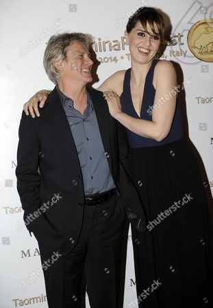Italian Actors Paola Cortellesi (r) and Giulio Scarpati (l) Pose For Photographs Before the Awards Ceremony at the Teatro Antico For the 60th Taormina Film Festival in Taormina Sicily Island Italy 19 June 2014 the Festival Runs From 14 to 21 June Italy Taormina