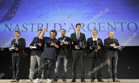 Italian Director Manetti Bros (3-l) Poses with Compatriot Actors Carlo Buccirosso (2-r) and Paolo Sassanelli (r) and Others at the 'Nastri D'argento' Award (silver Ribbon) 2014 During Awards Ceremony in the Teatro Antico Taormina Sicily Island Italy Late 28 June 2014 the Awards Are Presented Annually by the Sindacato Nazionale Dei Giornalisti Cinematografici Italiani (sngci) the Association of Italian Film Critics Italy Taormina