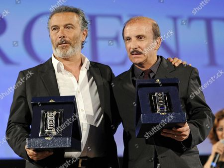 Stock Photo of Italian Actors Carlo Buccirosso (r) and Paolo Sassanelli (l) Pose with Their 'Nastri D'argento' Award (silver Ribbon) 2014 For 'Best Supporting Actor' During the Awards Ceremony in the Teatro Antico Taormina Sicily Island Italy Late 28 June 2014 the Awards Are Presented Annually by the Sindacato Nazionale Dei Giornalisti Cinematografici Italiani (sngci) the Association of Italian Film Critics Italy Taormina