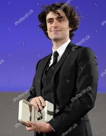 Italian Actor and Director Flavio Parenti Holds His 'Mr Clifton Award' He Received at the Awards Ceremony at the Teatro Antico During the 60th Taormina Film Festival Festival in Taormina Sicily Island Italy 19 June 2014 the Festival Runs From 14 to 21 June Italy Taormina