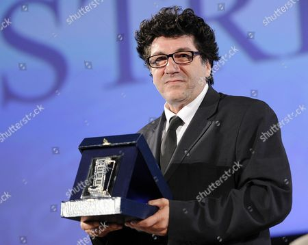 Stock Image of Italian Director of Photography Daniele Cipri Poses with His 'Nastri D'argento' Award (silver Ribbon) 2014 For 'Best Photography' For the Movie 'Salvo' During the Awards Ceremony in the Teatro Antico Taormina Sicily Island Italy Late 28 June 2014 the Awards Are Presented Annually by the Sindacato Nazionale Dei Giornalisti Cinematografici Italiani (sngci) the Association of Italian Film Critics Italy Taormina