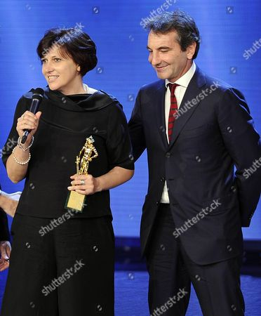 Italian Film Producers Nicola Giuliano (r) and Francesca Cima Receive the Best Producer Award For 'La Grande Bellezza' During the David Di Donatello Awards Ceremony in Rome Italy 10 June 2014 the Film Awards Are Presented Each Year to Honor the Best Italian and Foreign Cinematic Performances and Production Italy Rome