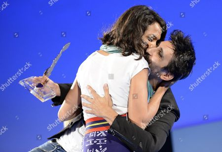 A Picture Made Available on 15 June 2015 Shows Italian Actor Fabrizio Biggio (r) Receiving the 'Cariddi Award' From Us Actress Rosario Dawson (l) During a Ceremony at the Teatro Antico As Part of the 61th Annual Taormina Film Festival Festival Taormina Sicily Island Italy Late 14 June 2015 the Festival Runs From 13 to 20 June Italy Taormina (messina)