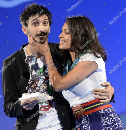 A Picture Made Available on 15 June 2015 Shows Italian Actor Fabrizio Biggio (l) Receiving the 'Cariddi Award' From Us Actress Rosario Dawson (r) During a Ceremony at the Teatro Antico As Part of the 61th Annual Taormina Film Festival Festival Taormina Sicily Island Italy Late 14 June 2015 the Festival Runs From 13 to 20 June Italy Taormina (messina)
