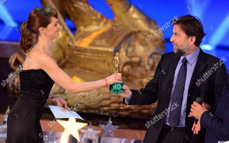 Italian Director Nanni Moretti (r) Receives (in Place of the French Actor Michel Piccoli not Present) the 'David Di Donatello' Best Actor Award For His Role in the Film ' Habemus Papam' by Italian Actress Paola Coltellesi (l) During the David Di Donatello Awards Ceremony in Rome Italy 04 May 2012 David Di Donatello Award is a Film Award Presented Each Year to Honour the Best of Each Years Italian and Foreign Motion Picture Productions Italy Rome
