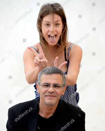Stock Photo of Tunisian-french Director Abdel Kechiche (front) Poses with French Actress Adele Exarchopoulos During a Photocall For 'La Vie D'adele' (blue is the Warmest Color) in Rome Italy 16 October 2013 the Movie Will Be Released in Italian Cinemas on 24 October Italy Rome