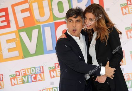 Italian Filmmaker and Actor/cast Member Vincenzo Salemme (l) and Italian Actress/cast Member Margareth Made (r) Pose For Photographs During the Photocall For the Movie ' E Fuori Nevica' in Rome Italy 09 October 2014 the Movie Will Be Released in Italian Theaters on 16 October Italy Rome