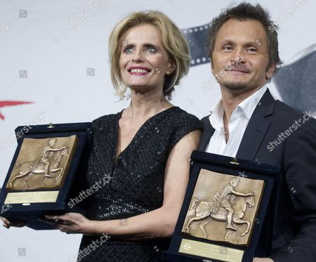 Stock Image of Italian Actress Isabella Ferrari and Director Paolo Franchi Hold the 'Golden Marc'aurelio' Awards They Received For 'E La Chiamano Estate' (and They Call It Summer) at the 7th International Rome Film Festival in Rome Italy 17 November 2012 Italy Rome