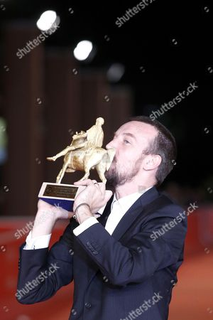 Stock Photo of Alberto Fasulo Holds the 'Golden Marc'aurelio' Award They Received For Their Documentary 'Tir' at the 8th International Rome Film Festival in Rome Italy 16 November 2013 Italy Rome