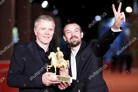 Stock Picture of Branko Zavrsan (l) and Alberto Fasulo Hold the 'Golden Marc'aurelio' Award They Received For Their Documentary 'Tir' at the 8th International Rome Film Festival in Rome Italy 16 November 2013 Italy Rome