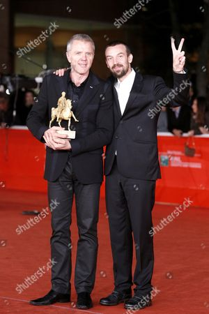 Branko Zavrsan (l) and Alberto Fasulo Hold the 'Golden Marc'aurelio' Award They Received For Their Documentary 'Tir' at the 8th International Rome Film Festival in Rome Italy 16 November 2013 Italy Rome