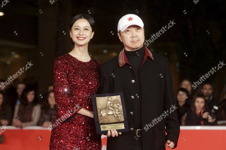 Chinese Actor Ni Hong Jie (l) and Chinese Musician Cui Jian Hold the 'Special Mention Award' For 'Blue Sky Bones' at the 8th International Rome Film Festival in Rome Italy 16 November 2013 Italy Rome