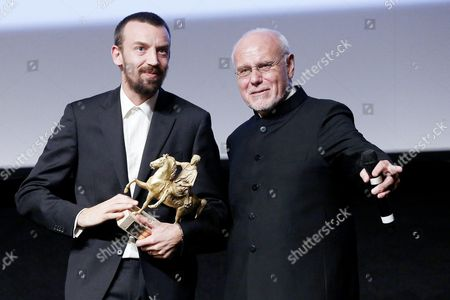 Stock Image of Alberto Fasulo with His Marc'aurelio Award For 'Tir' and Marco Muller During the Closing Night of the 8th Annual Rome Film Festival in Rome Italy 16 November 2013 Italy Rome