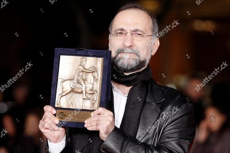 Stock Image of Tayfun Pirselimoglu Holds His Award For Best Screenwriting He Received For 'I Am not Him' at the 8th International Rome Film Festival in Rome Italy 16 November 2013 Italy Rome
