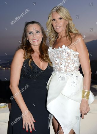 Stock Image of Italian Actress Barbara De Rossi (l) and Italian Festival General Manager Tiziana Rocca Pose For a Photograph During a Party During the Taormina Film Festival at the Teatro Antico in Taormina Sicily Island Italy 26 June 2012 the 58th Edition of the Festival Runs From 22 Until 28 June Italy Taormina