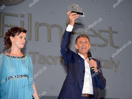 Italian Actor and Director Ezio Greggio (r) Poses For a Photograph After He Received the Taormina City-box Office 3d Award From Italian Actress Giorgia Wurth During the Taormina Film Festival at the Teatro Antico in Taormina Sicily Island Italy 25 June 2012 the 58th Edition of the Festival Runs From 22 Until 28 June Italy Taormina