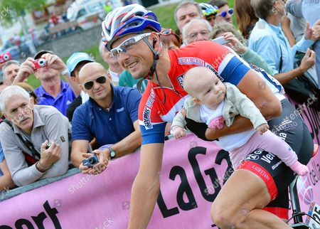 Dutch Cyclist Johnny Hoogerland of the Androni Giocattoli-venezuela Team Carries His Daughter Saar Prior to the Start of the 17th Stage of the 97th Giro D'italia Cycling Race Over 208km From Sarnonico to Vittorio Veneto Italy 28 May 2014 Italy Sarnonico