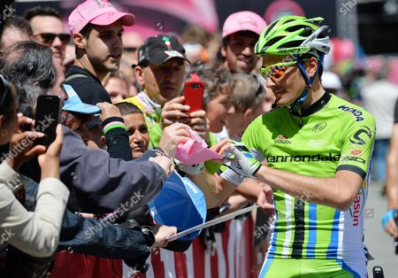 Italian Rider Ivan Basso (r) of the Cannondale Team Signs Autographs Prior to the Start of the Eighth Stage of the 97th Giro D'italia Cycling Race Over 179km From Foligno to Montecopiolo Italy 17 May 2014 Italy Foligno
