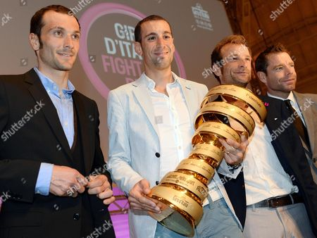(l-r) Italian Riders Ivan Basso Vincenzo Nibali Michele Scarponi and Australia's Cadel Evans Pose with the Winner's Trophy During the Presentation of the Route of the 2014 Giro D'italia Cycling Race in Milan Italy 07 October 2013 Italy Milan