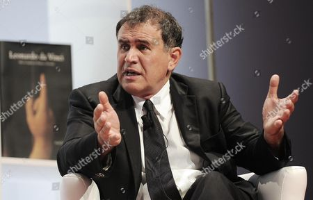 Us Economist Nouriel Roubini Speaks During the World Business Forum in Milan Italy 07 November 2012 Roubini Hailed the Re-election of President Barack Obama As 'Positive For the United States and the Rest of the World' Speaking at the World Business Forum Milan Roubini Said Obama Would Be Able to Strike a Balance Between the Public and Private Sectors Something That is Fundamental For 'A Successful Economy Which Must Anchor Itself to Private Businesses But Having the Guarantee of Public Services From the State is Fundamental' Italy Milan