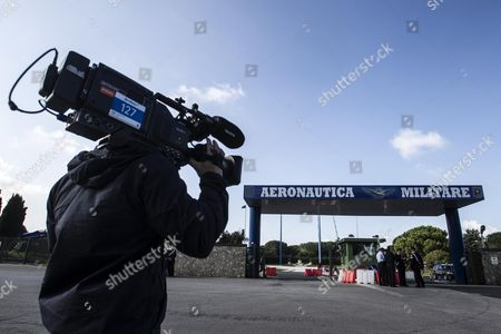 A Television Camera Man Outside the Pratica Di Mare Military Airport Near Rome where the Coffin of the German War Criminal Erich Priebke Has Been Taken on 16 October 2012 an Italian Government Official Saidon 16 October 2013 That the Country was in Talks with Germany Over the Fate of a Dead Nazi War Criminal Whose Funerals Were Called Off a Day Earlier Due to Street Protests the Body of Erich Priebke was Taken Overnight to a Military Airport Near Rome After Riots Prevented His Closed-door Funerals From Being Celebrated by an Ultra-traditionalist Catholic Group with Anti-semitic Views Italy Rome (italy)