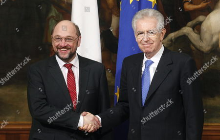Italian Prime Minister Mario Monti (r) Shakes Hands with European Parliament President Martin Schulz (l) During Their Meeting Chigi Palace Rome Italy 23 February 2012 Ep-president Martin Schulz is on an Official Visit to Italy with Meetings with Italian President Giorgio Napolitano Prime Minister Mario Monti Parliament Speaker Gianfranco Fini and Senate Speaker Renato Schifani President Schulz Will Also Attend a Ceremony in Bologna City Hall to Commemorate the Marzabotto Massacre and Visit the Monte Sole Memorial There in Honour of the Hundreds of Victims of Waffen Ss Reprisals During World War Ii Epa/maurizio Brambatti Italia Roma