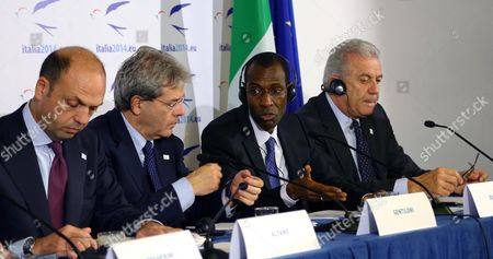 (l-r) Italian Interior Minister Angelino Alfano Italy's Foreign Minister Paolo Gentiloni Silveri Senegal's Interior Minister Abdoulaye Daouda Diallo and Dimitris Avramopoulos Eu Commissioner For Migration Home Affairs and Citizenship Attend a Joint News Conference After the Plenary Session in the Context of the 'Process of Rabat' Discussion of the Euro-african Meeting in Rome 27 November 2014 Italy Rome